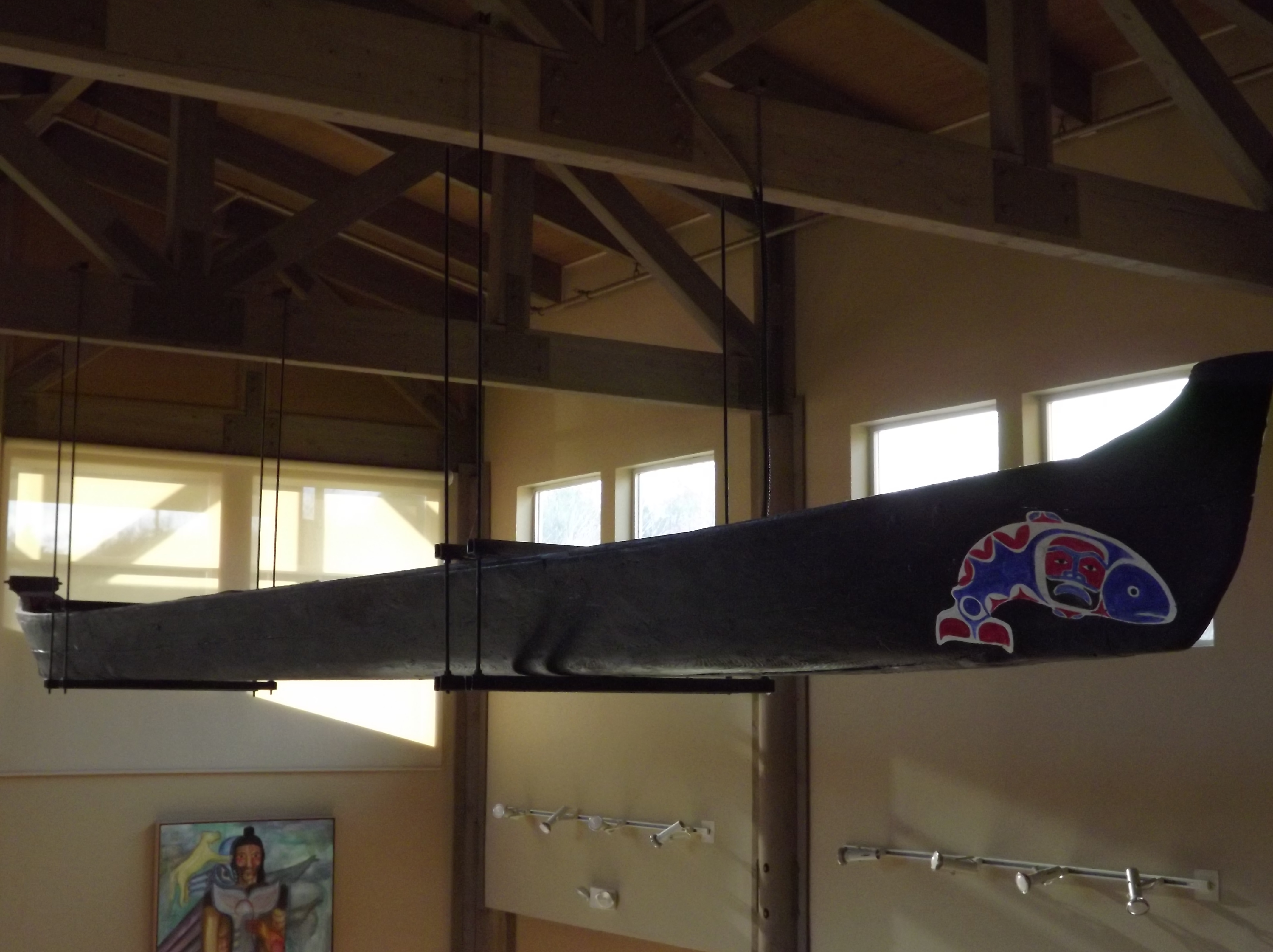 Photo of tribal canoe hanging in a building