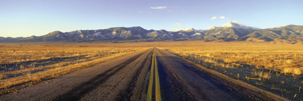 Highway leading toward mountains in the Great Basin